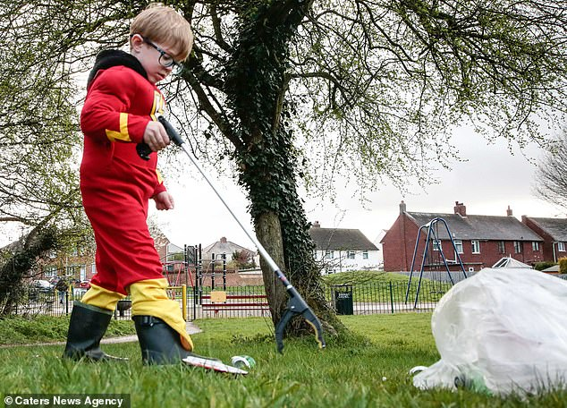 Caped crusader, four, dresses as his favourite superhero The Flash to spend hundreds of hours ridding his home town of litter